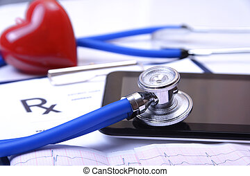 Closeup of stethoscope on a rx prescription and phone