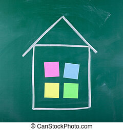 sticky notes stuck in house shape drawing on black board -...