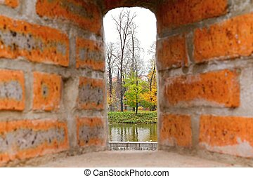 Photo shows a detailed closeup of the stone wall background with window.