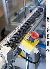 Closeup of Stop button on the assembly line