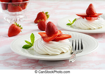 strawberry meringue nests with a fork