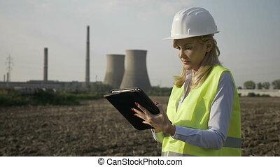 Closeup of successful worker engineer woman using digital...