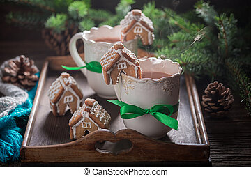 Closeup of sweet drink and gingerbread cottages for Christmas