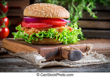 Closeup of tasty burger with vegetables