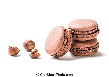 Closeup of tasty macaroons with nut on white background
