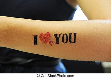 """I love you - closeup of tatoo """"I love you"""" at woman hand"""