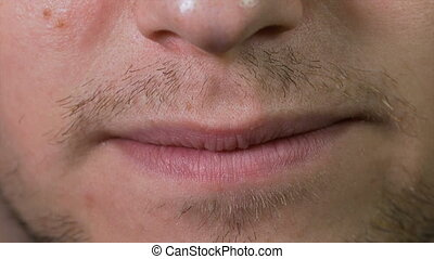 Closeup of teenager mouth expressing grimaces talking and...