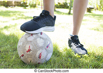 closeup of the foot of child with soccer ball