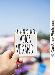 text adios verano, good bye summer in spanish - closeup of...