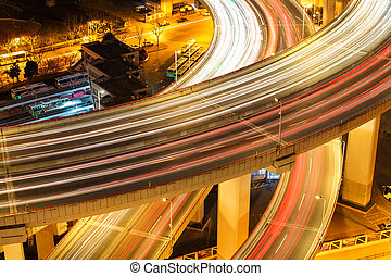 closeup of the light trails on overpass