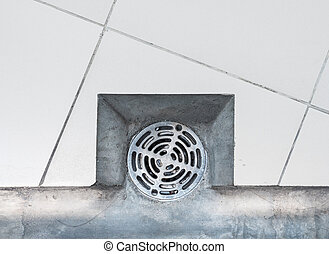 Closeup of the metal cover for the drainage.