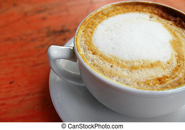 closeup of the top of a cappuccino coffee