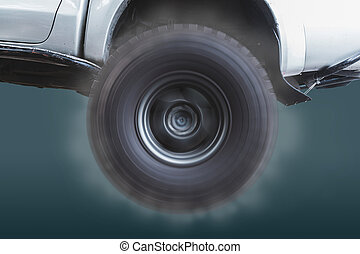 Closeup of the wheels of off-road vehicles that are rotating at high speed.