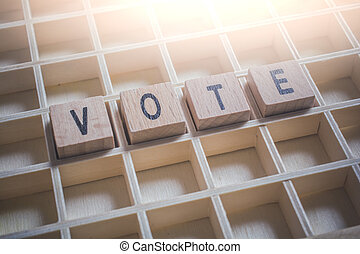 Closeup Of The Word Vote Formed By Wooden Blocks In A...