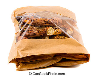 Closeup of three bagels in a brown paper bag