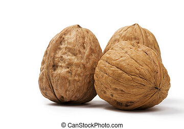 closeup of three walnuts on white background