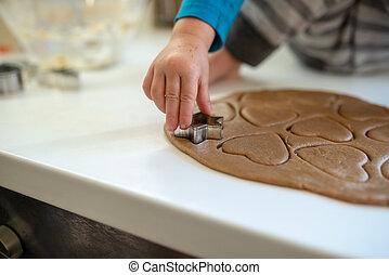 Closeup of toddler child making cookies