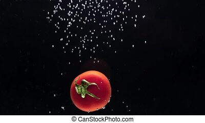 closeup of tomato with air bubbles. Slowmo FHD footage.