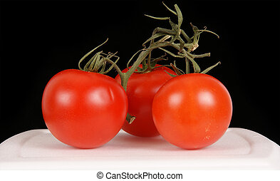 Closeup of tomatoes in black and white background