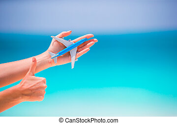 Closeup of toy airplane background the turquoise sea