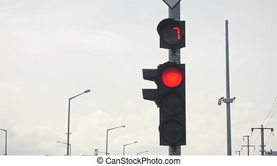 closeup of traffic light with numbers counting down