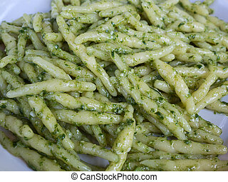 closeup of trofie al pesto: handmade pasta with basil sauce