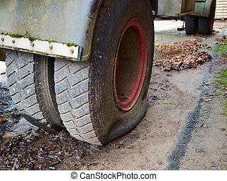 Closeup of truck flat tire road safety