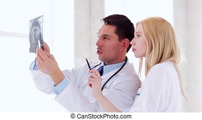 two doctors with x-ray prints - closeup of two doctors with...