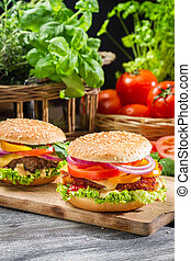 Closeup of two homemade burgers made ??from fresh vegetables