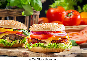 Closeup of two homemade hamburgers made from fresh vegetables