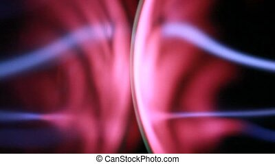 Closeup of two plasma ball, energy rays move inside