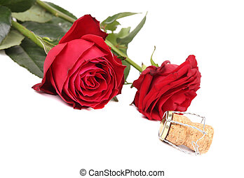 Closeup of two roses and a cork.