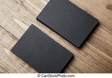 Closeup of two stack Of blank black business cards on wooden background