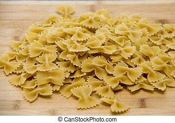 Closeup of uncooked italian pasta - farfalle