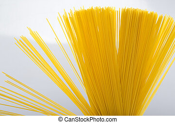 Closeup of uncooked spaghetti noodles