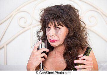 Closeup of Upset Woman Drinking Wine in Bedroom