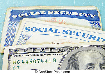closeup of US money and Social Security cards
