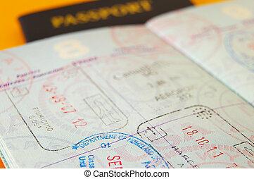 Closeup of US passport with international stamps