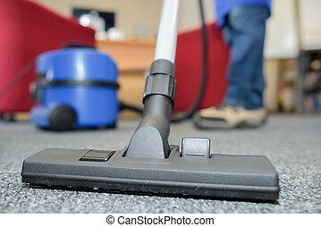 Closeup of vacuum cleaner carpet attachment