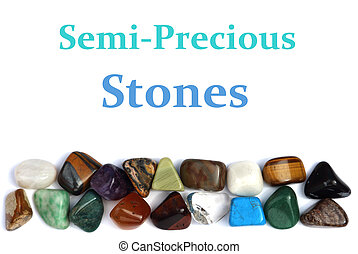 Closeup of various colorful stones over white background
