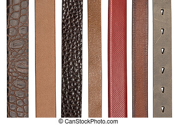 Closeup of various leather belts isolated on white ...