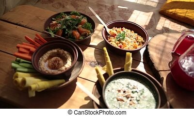 Closeup of vegetarian food on rustic wooden table - Closeup...