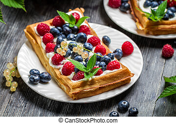 Closeup of waffles with fresh berry fruit