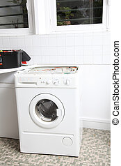 Closeup of washing machine in laundry