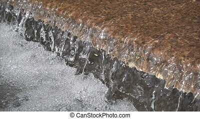 closeup of water fall in fountain, slow motion