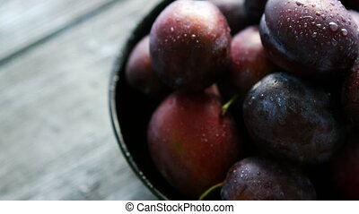 Closeup of wet fresh plums