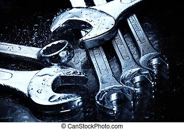 Closeup of wet iron spanners set