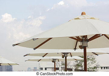 white beach umbrella with sky background
