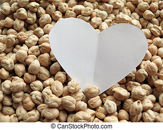 Closeup of White Heart shape on pattern of chickpeas. healthy food