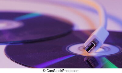 Closeup of white Mini Displayport cable with it's reflection...